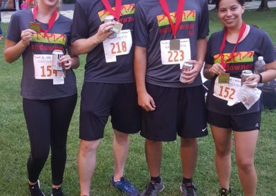 Besarta, Tom, Sam and Gabby with Sundowner 5K Medals